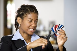 Frustrated Businesswomen Cutting up Credit Cards